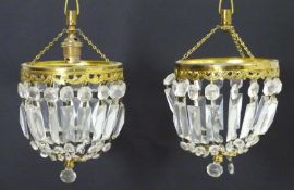 """A pair of 20thC pendant bag chandeliers, the cut glass droplets suspended from gilt mounts. 6"""""""