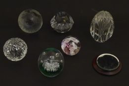 """6 Assorted glass paperweights including a Caithness example. The largest 41/4"""" Please Note - we do"""
