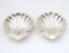 A pair of butter dishes / shells of scallop shell form. Hallmarked Birmingham 1906 maker Elkington &