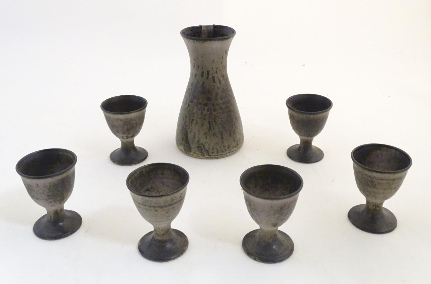 A studio pottery wine caraf and 6 goblets by Howard and Kathleen Charles, Masham Pottery. - Image 4 of 7