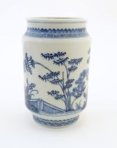 A Chinese blue and white vase of cylindrical form with garden terrace with trees and blossom