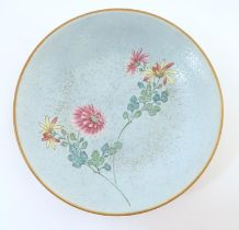 """A Chinese plate with stylised peony flower detail. Character marks under. Approx. 6"""" diameter Please"""