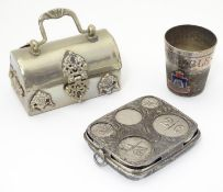 Three silver plate items comprising a coin holder, small box of casket form and an oversized thimble