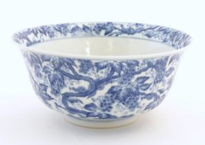 A Chinese blue and white bowl decorated with vine leaves and grapes. Character marks under.