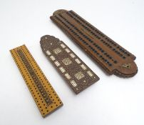 Toys: Three early 20thC cribbage peg boards, comprising a far eastern example with foliate carved