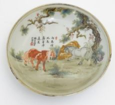 A small Chinese famille rose dish, decorated with three horses in a landscape with gilt