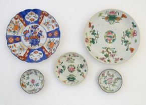 Five assorted Oriental plates to include famille rose plates with floral and foliate detail, each