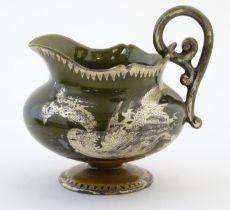 "An Oriental pedestal cream jug with gilt dragon detail. Impressed marks under. Approx. 4"" high"