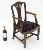 A 19thC mahogany Chippendale style childs chair with a shaped top rail and pierced fanned backrest