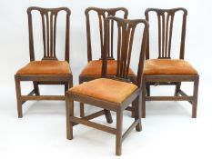 Four mahogany Chippendale side chairs with shaped top rails and pierced fanned back splats above