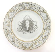 A Chinese export plate depicting a grisaille portrait of Martin Luther flanked by two angels. The