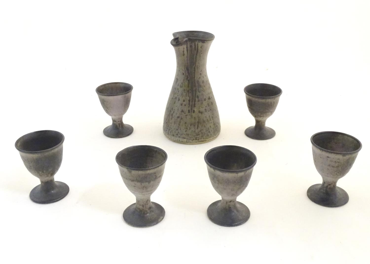 A studio pottery wine caraf and 6 goblets by Howard and Kathleen Charles, Masham Pottery.