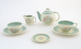 A quantity of Susie Cooper tea wares in the pattern Dresden, comprising a teapot, milk jug, two cups