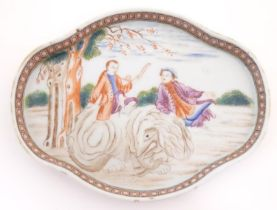 A Chinese export dish of quatrefoil form depicting a landscape scene with a man playing a horn