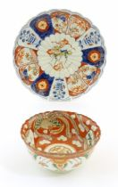 An Oriental plate in the Imari palette decorated with big cat / leopard / cheetah to centre and a