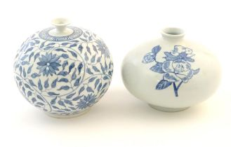 An Oriental blue and white vase of globular form decorated with flowers and foliage. Character marks