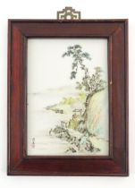 A Chinese porcelain plaque decorated with a coastal scene. Character marks lower left. Approx. 9 1/