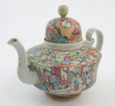 A Chinese famille rose teapot decorated with figures drinking tea, figures on a terrace with fans,