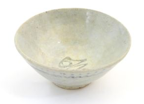 """An Oriental earthenware bowl of tapering form with brushwork detail. Approx. 2 1/4"""" high x 5"""""""
