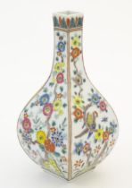 An Oriental vase of squared form decorated with flowers and birds. Possibly Japanese. Character