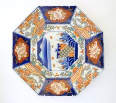 A Japanese octagonal plate in the Imari palette decorated with birds, flowers and foliage, with