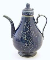 """A Chinese pear shaped teapot with phoenix bird decoration to body. Approx. 8 3/4"""" high Please Note -"""