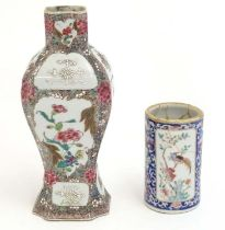 A Chinese vase with panelled peony and flower decoration. Together with a Chinese brush pot of