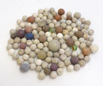 Toys: A quantity of assorted Victorian marbles to include hand painted ceramic examples, etc. Please