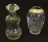 A cut glass scent / perfume bottle with silver collar hallmarked Birmingham 1902 together with a cut