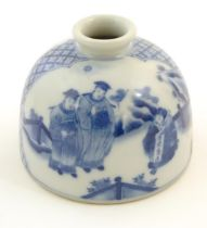A Chinese blue and white ink pot of dome form decorated with scholars with scrolls in a landscape.