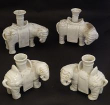 """Four Chinese blanc de chine bud vases modelled as elephants. Largest 6 1/2"""" high (4) Please Note -"""