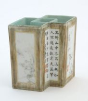 A Chinese brush pot of geometric form, decorated with grisaille landscape scenes, bamboo shoots