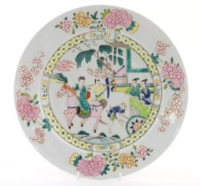 A Chinese famille rose plate depicting a landscape scene with a figure on horse back with an
