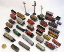 Toys: A quantity of assorted Hornby Meccano O and OO gauge rolling stock / trains and railway