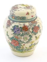 An Oriental ginger jar and cover with inner lid, decorated with flowers and foliage. Possibly