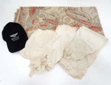 A quantity of assorted lace, fabric etc. Together with a Bentley cap