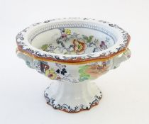 A Masons Ironstone pedestal tureen with chinoiserie decoration depicting Oriental landscapes with