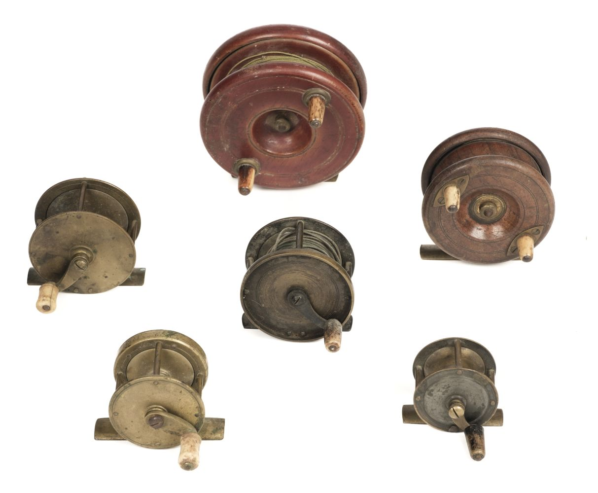 * Fishing Reels. A collection of brass and wooden reels