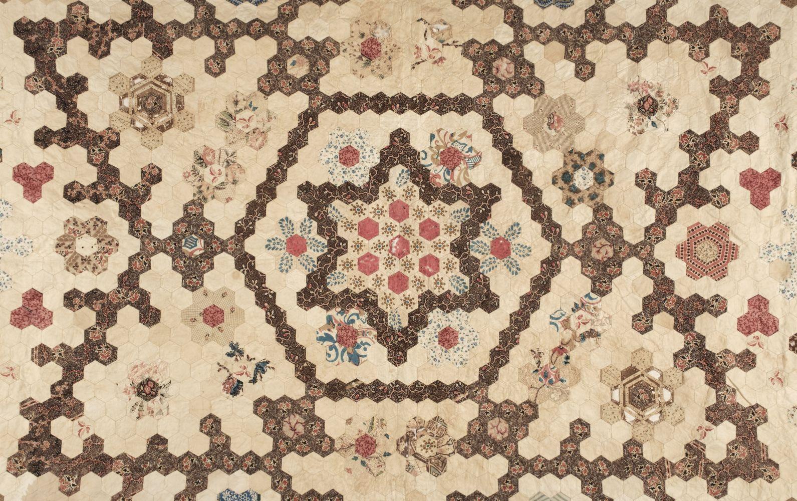 * Quilt. A Victorian patchwork hexagon quilt, English