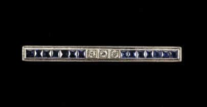 * Brooch. Art Deco diamond and sapphire bar brooch