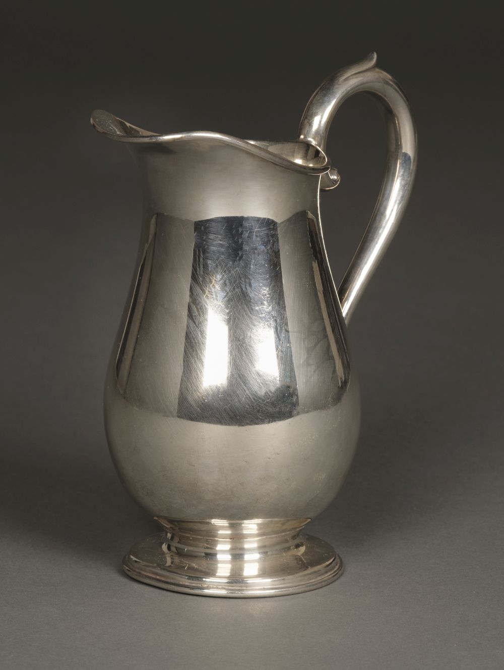 * Jug. Edwardian silver baluster jug by Cooper Brothers & Sons, Sheffield 1924