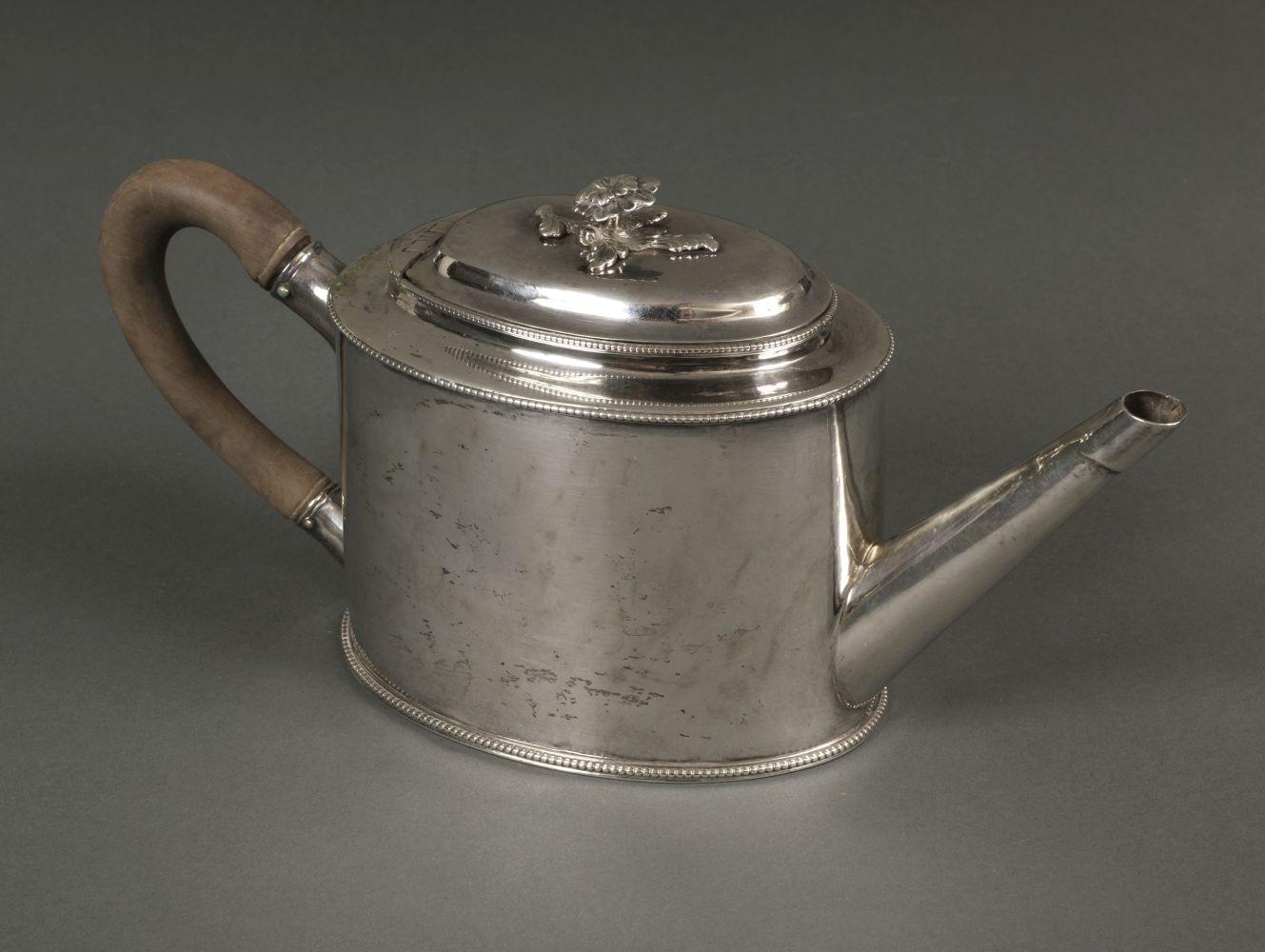 * Teapot. A George III silver teapot by William Turton, London 1783