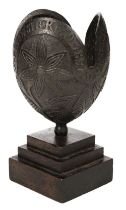 * Coconut. A 19th century carved coconut