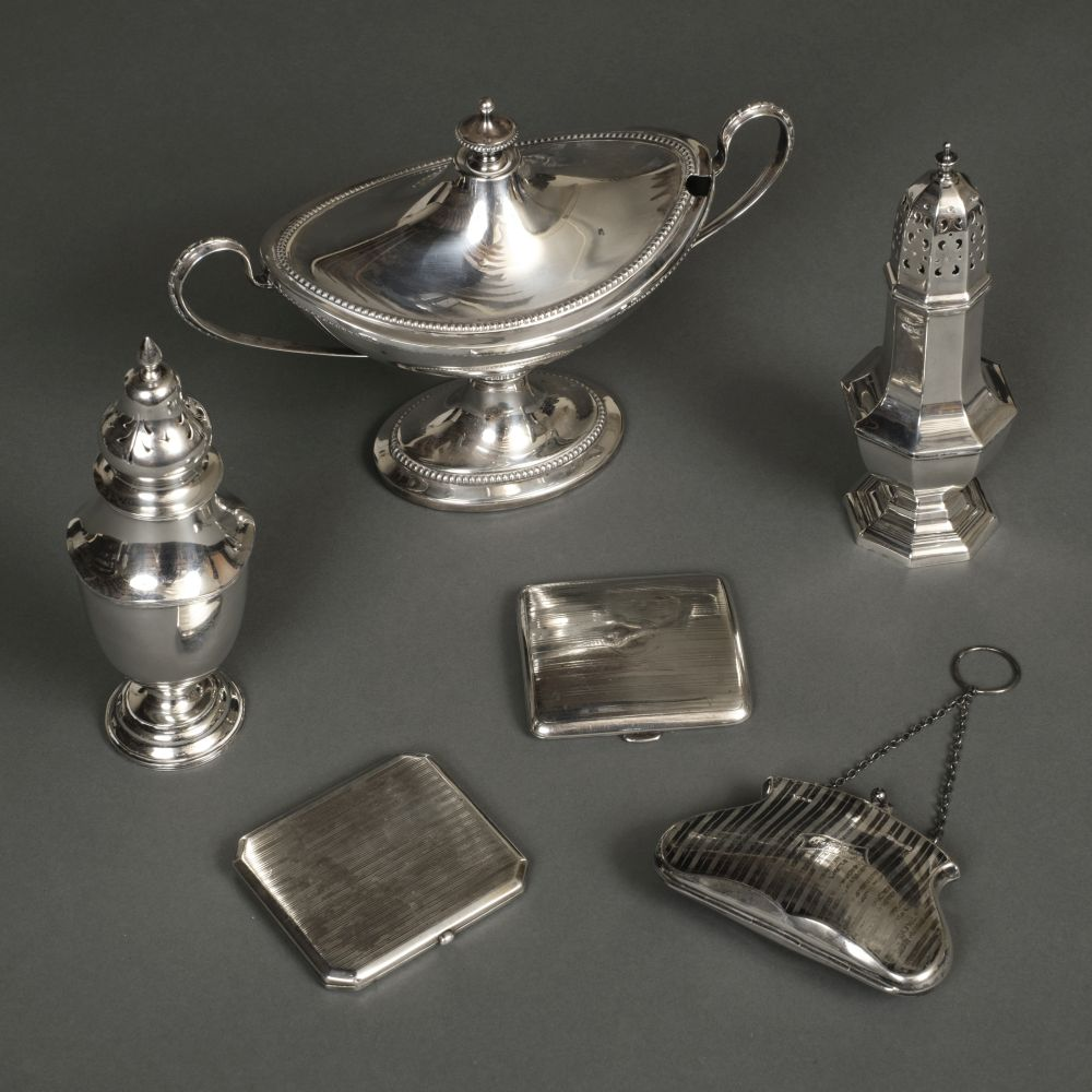 * Mixed Silver. A George V silver sugar caster, cigarette cases and other items