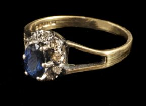 * Ring. An 18ct gold sapphire and diamond cluster ring