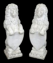 * Lions. A pair of reconstituted stone lions