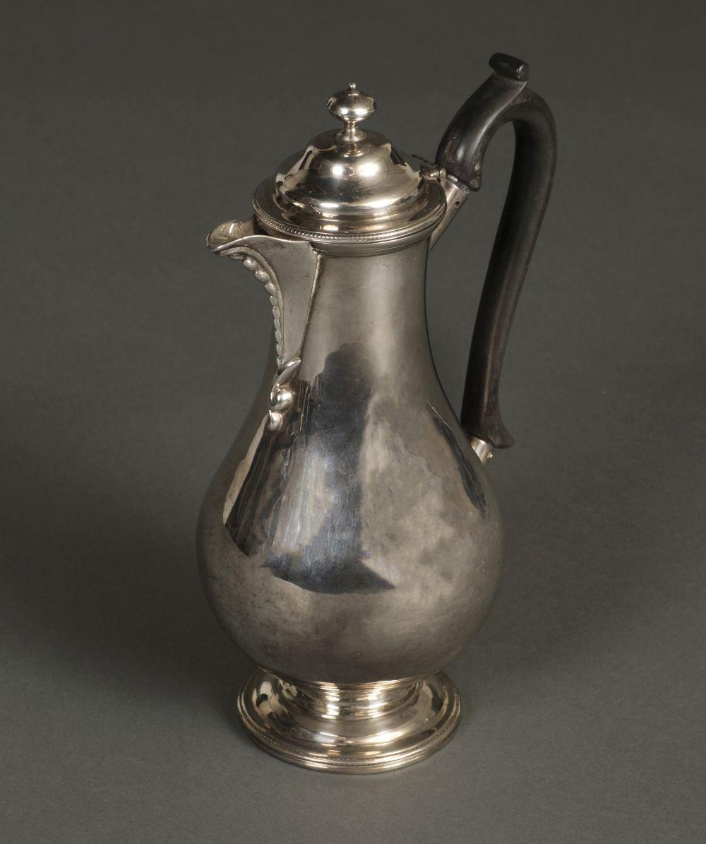 * Coffee Pot. A George V silver coffee pot by CS Harris, London 1926