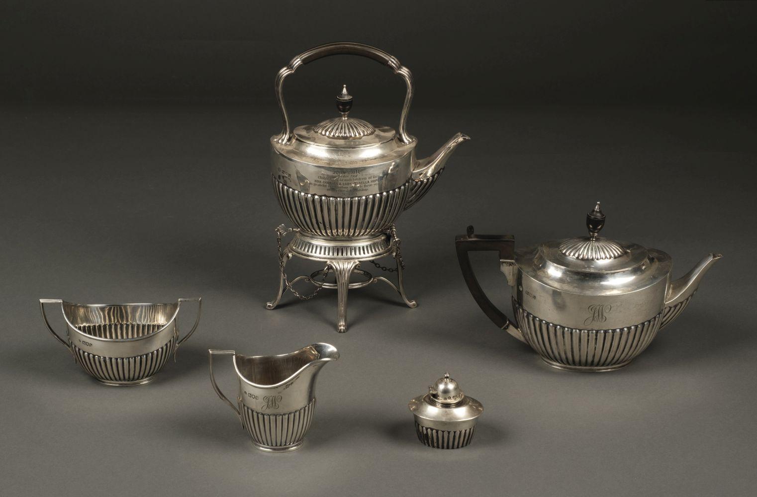 * Tea Set. An Edwardian silver 4-piece tea set