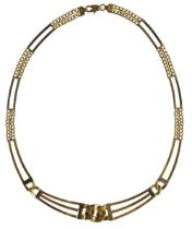 * Necklace. A modern gold necklace stamped '750'
