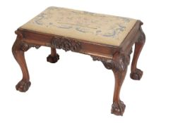 A VICTORIAN CARVED WALNUT AND BERLIN WOOLWORK UPHOLSTERED STOOL, IN GEORGE III STYLE,